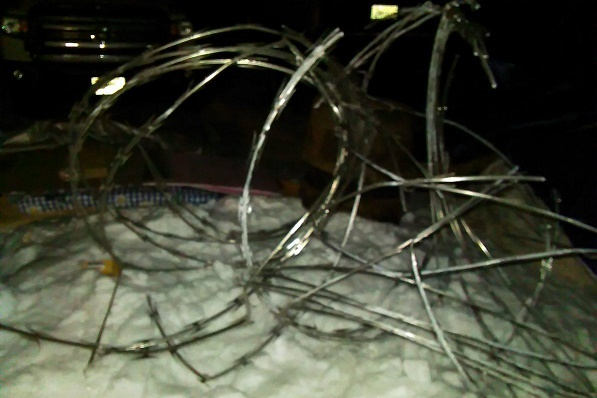 Concertina wire creates barrier to the water protectors at DAPL. Photo Credit: Joseph Hock.